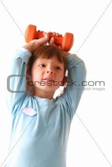 Little girl with dumbbell