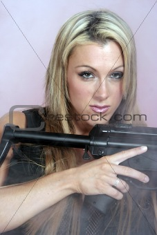 a woman with a weapon