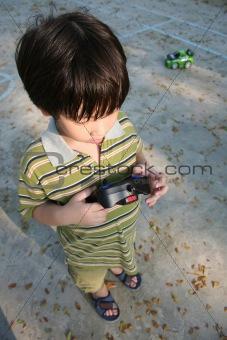 Boy playing remote control car