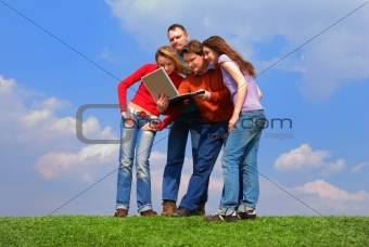 Group of people with notebook