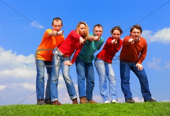 Group of people pointing to camera