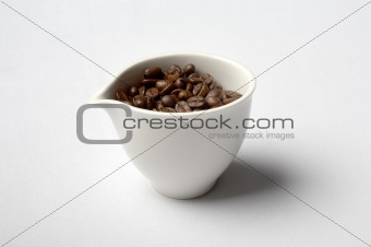 cup full of colombian coffee beans