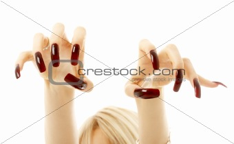 aggressive girl hands with long acrylic nails
