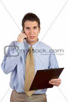 Serious businessman talking with cell phone