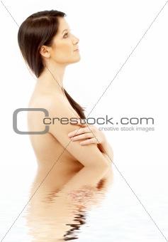 topless brunette in water