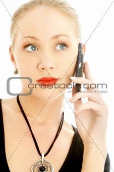 portrait of elegant blond using cellular phone