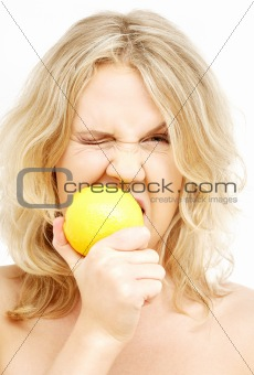lovely blond biting lemon