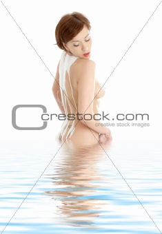 topless girl with soap foam on spine in water
