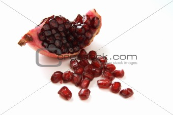 quarter of dark ruby pomegranat and grains 