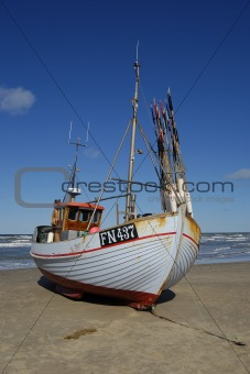 Fishing boat pulled ashore