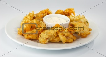 Battered pike perch with white sauce.