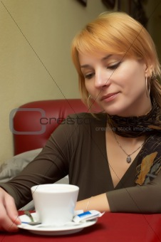 Beauiful girl having a break with coffee
