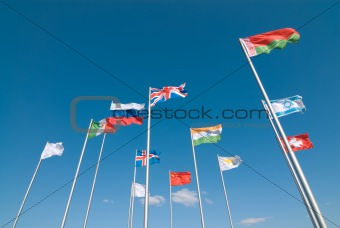 Flags waving across deep blue sky