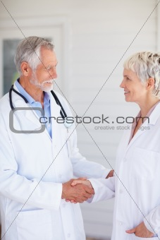 Senior doctor conversing with his colleague