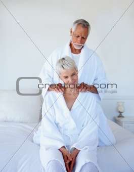 Man giving a shoulder massage to his wife