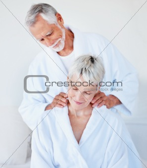 Husband giving a massage to his wife