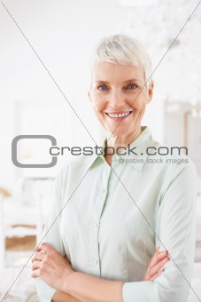 Smiling senior woman with arms crossed