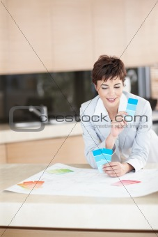 Closeup of young business woman holding swatches