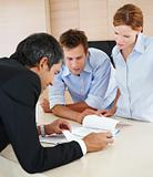 Financial advisor consulting with young couple