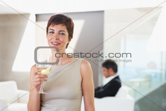 Attractive young business woman celebrating