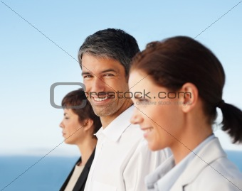 Portrait of happy business group standing together