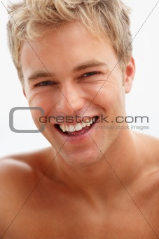 Closeup portrait of a handsome happy young guy