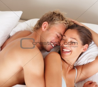 Smiling romantic young couple at home