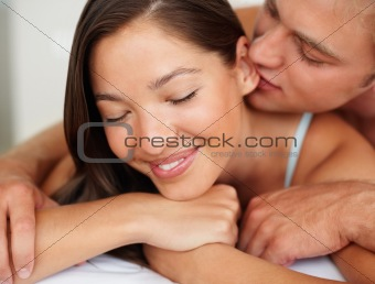 Closeup of a romantic young couple during foreplay