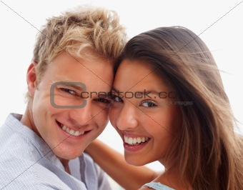 Closeup of a smiling romantic young couple