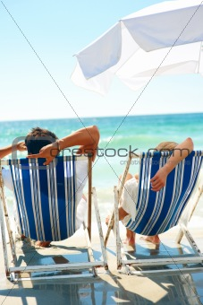 Young couple relaxing at beach