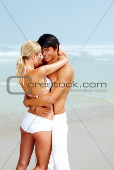 Young couple walking at beach