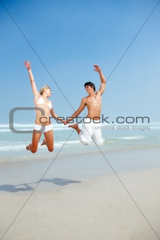 Young couple enjoying together at beach