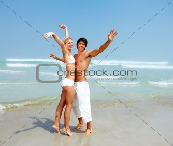 Young couple enjoying themselves at beach