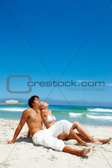 Young couple resting on the beach
