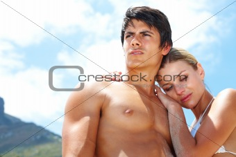 Relaxed young couple together on the beach