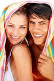 Cute young couple with a towel on their head