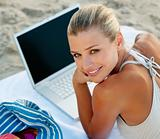 Happy smiling woman with laptop on beach