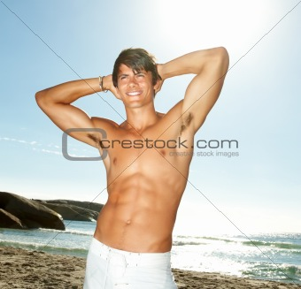 A handsome smart guy posing at beach