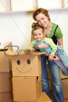 Little girl and woman with cardboard boxes