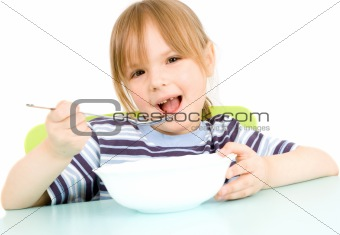 child eat soup