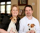 Happy Couple with Their Dogs