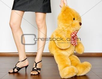 toy between girl legs