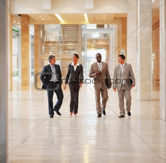 Portrait of businesspeople walking together and discussing