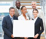 Group of business people holding an empty billboard