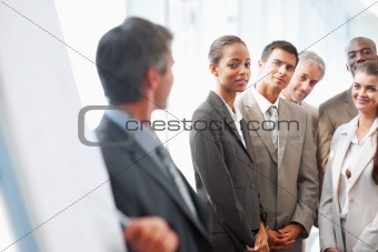 Group of business colleagues being lectured by a speaker