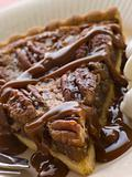 Slice Of Pecan Pie With Caramel Sauce And A Fork