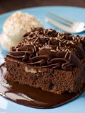 Chocolate Fudge Brownie With Chocolate Fudge Sauce And Cream