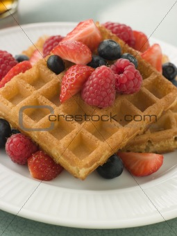 Plate Of Waffles With Berries And Maple Syrup