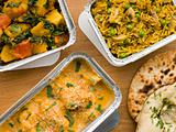 Selection Indian Take Away Dishes In Foil Containers