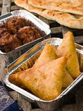 Indian Take Away- Vegetable Samosa, Naan Bread And Onion Bahji